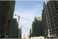 目前施工的11栋楼都已封顶_1